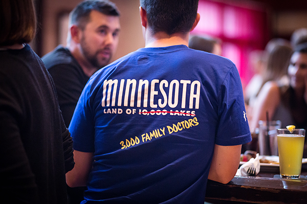 Blue Minnesota Academy of Family Physicians t-shirt that says Minnesota: Land of 3,000 family doctors.